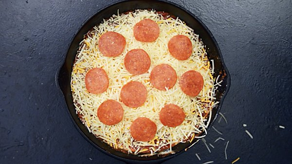 Layered loaded pizza dip unbaked