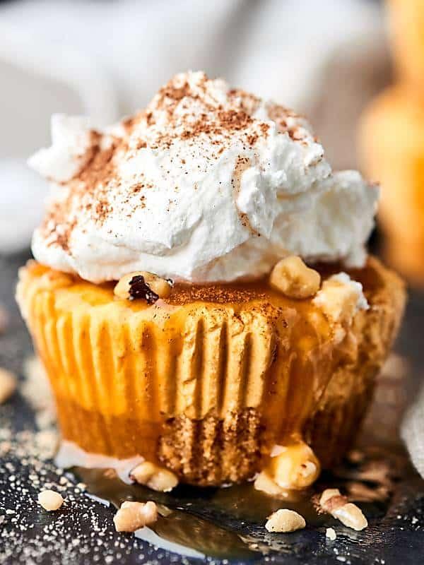mini pumpkin cheesecake topped with whipped cream