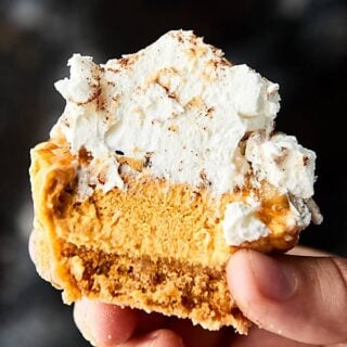 These No Bake Mini Pumpkin Cheesecakes are the perfect fall or holiday dessert! A simple graham cracker crust topped with a cream cheese, pumpkin, cool whip filling! Don't forget the nuts and caramel drizzle! showmetheyummy.com