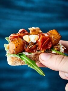 Roasted Butternut Squash Bruschetta. Chewy baguette topped with goat cheese, arugula, roasted butternut squash and tomatoes! showmetheyummy.com