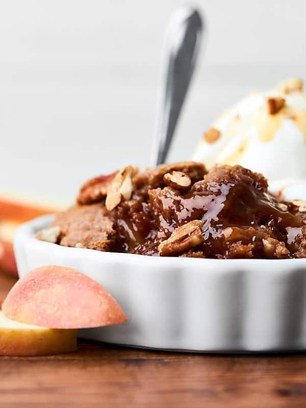 Caramel apple dump cake in bowl side view