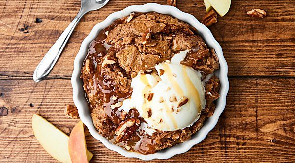 ThisSlow Cooker Caramel Apple Dump Cake Recipe might be my easiest recipe yet! Only 5 ingredients: apple pie filling, pecans, caramel, spice cake mix, and butter! showmetheyummy.com