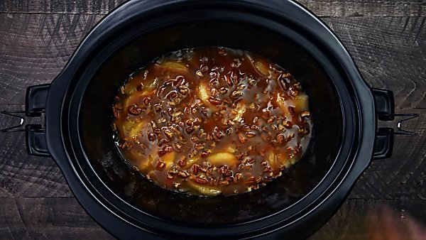 caramel sauce and pecans in crockpot