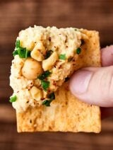 This Syrian Hummus Recipe is simple to make and packed with flavor! Full of chickpeas, lemon, tahini, and garlic, it's so delicious and ultra creamy! showmetheyummy.com