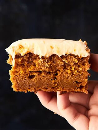 Easy Pumpkin Bars Recipe with Cream Cheese Frosting. These bars are ultra dense and full of all your favorite pumpkin pie spices! Topped with the smoothest, tangy cream cheese frosting! showmetheyummy.com
