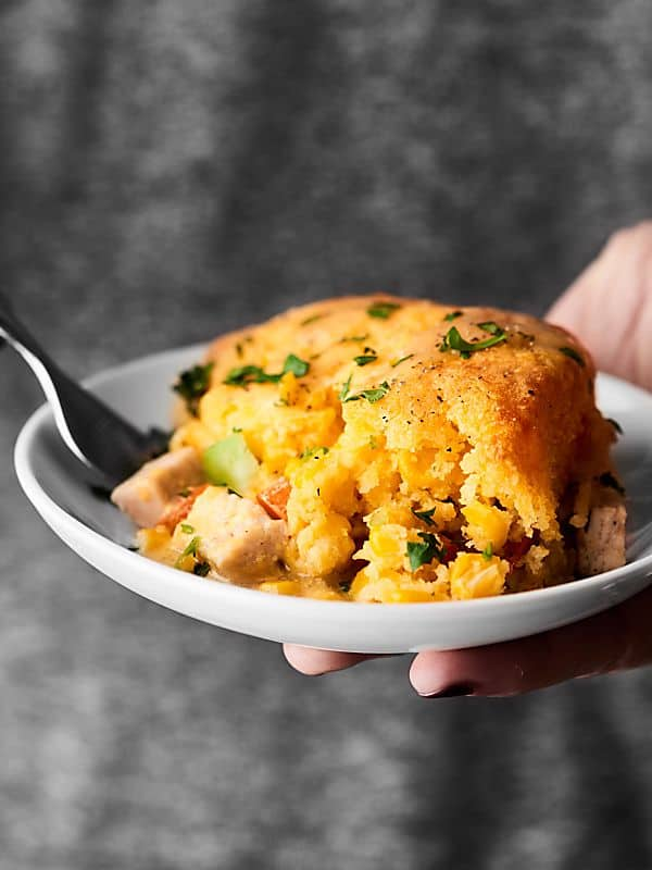 #ad This Leftover Turkey Cornbread Casserole is the PERFECT way to revive Thanksgiving leftovers. Turkey and veggies topped with gravy and an easy cornbread! showmetheyummy.com #SwitchCircle #JennieO