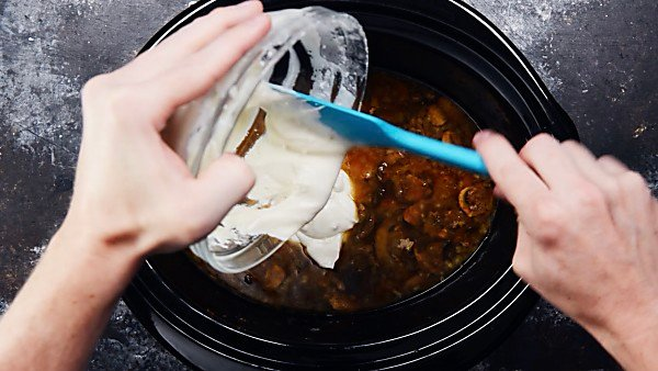 Roux being poured into crockpot mixture