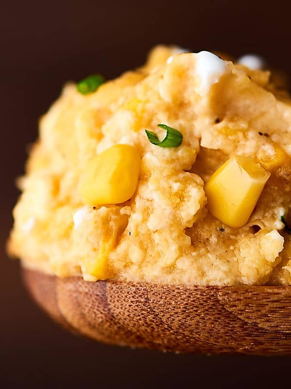 This Slow Cooker Corn Pudding is SO easy to make and is loaded with corn, cornbread mix, sour cream, cream cheese, cheddar cheese, and more! Perfect for the holidays! showmetheyummy.com