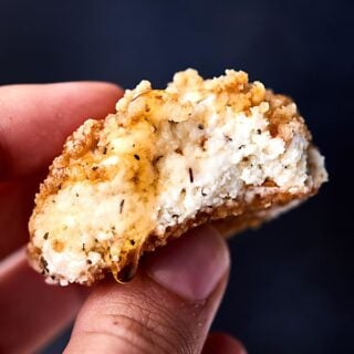 #ad Warm Walnut Goat Cheese Bites. Goat cheese mixed with honey and spices, rolled in crushed walnuts, and baked until warm!showmetheyummy.com Made in partnership w/ @CAWalnuts