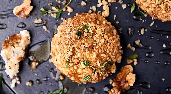 #ad Warm Walnut Goat Cheese Bites. Goat cheese mixed with honey and spices, rolled in crushed walnuts, and baked until warm! showmetheyummy.com Made in partnership w/ @CAWalnuts