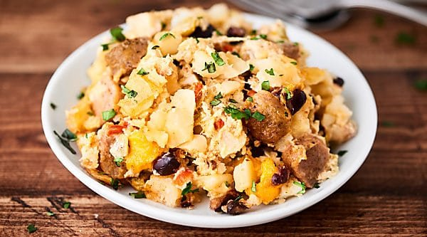 Crockpot Breakfast Casserole. Full of hash browns, sausage, black beans, TWO kinds of cheese and loads of spices. Quick, easy, and so yummy! Gluten free. showmetheyummy.com #crockpot #breakfast