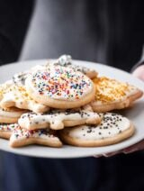 Cut out sugar cookies with cream cheese frosting! These are perfectly golden on the outside yet remain fluffy in the middle! showmetheyummy.com #sugarcookies #cookies #creamcheese #frosting