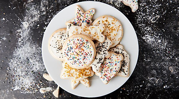 Cut out sugar cookies with cream cheese frosting! These are perfectly golden on the outside yet remain fluffy in the middle! showmetheyummy.com #sugarcookies #cookies