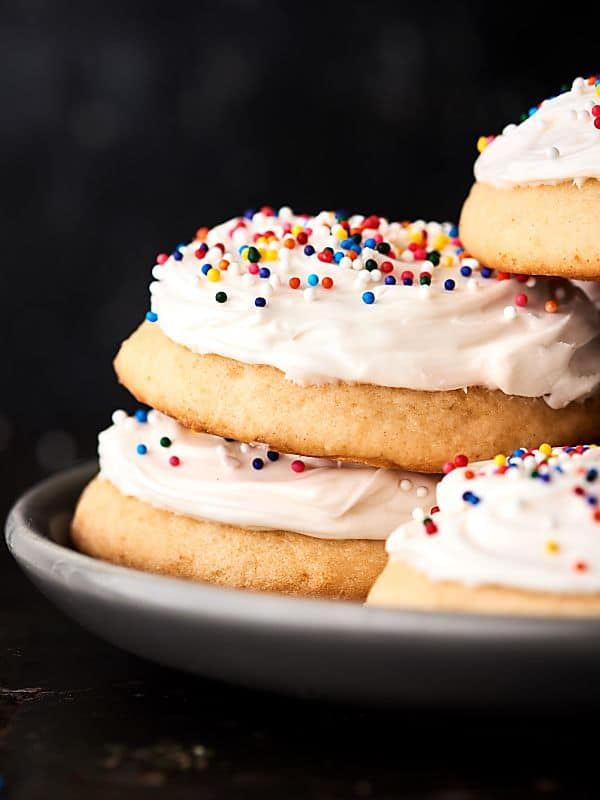 These really are Grandma's Best Sugar Cookies! They're perfectly soft, a little bit chewy, with the right amount of tang from the sour cream. Don't forget the buttercream frosting! showmetheyummy.com #sugarcookies #cookies