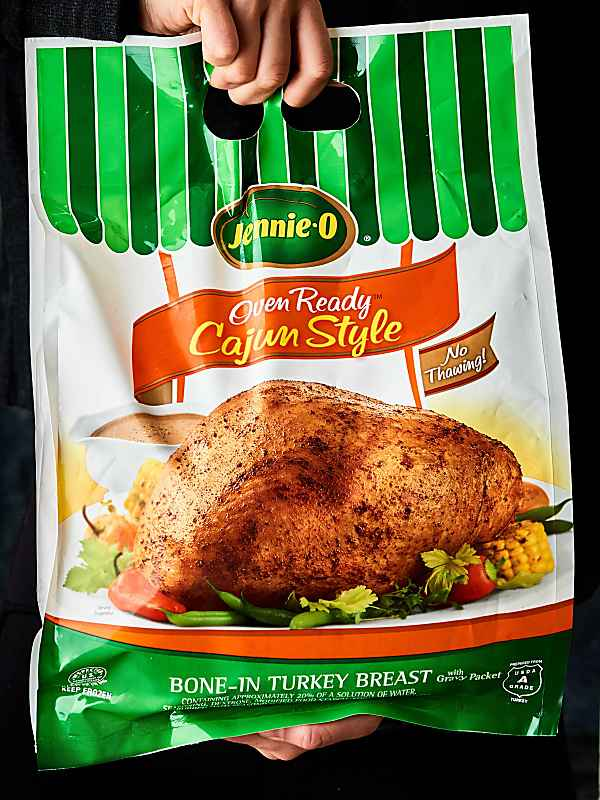 package of Jennie-O turkey breast held