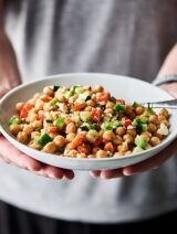 This Chopped Chickpea Greek Salad Recipe is the perfect vegetarian, gluten free light lunch or side dish! Full of chickpeas, chopped veggies, and smothered in a tangy greek yogurt and herb dressing! showmetheyummy.com #vegetarian #salad