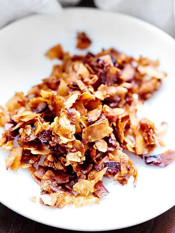 "Easy Coconut Bacon. A vegan alternative to ""real bacon""! Made with coconut, soy sauce, liquid smoke, and maple syrup! Gluten free! Ready in 15 minutes! showmetheyummy.com #vegan #coconutbacon"