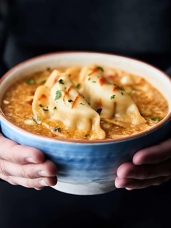 This Egg Drop Wonton Soup is a twist on three of my FAVE Asian soups: hot and sour, egg drop, and wonton soup! Ready in about 15 minutes. Healthy and can be vegetarian! showmetheyummy.com #soup #healthy