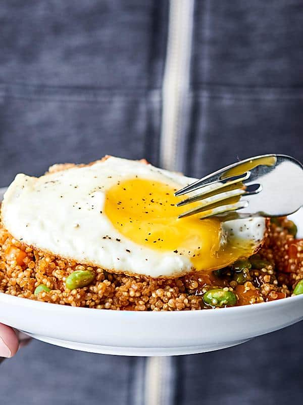 #ad This Quinoa Fried Rice Recipe is an easier, healthier version of a take out classic! Loaded with leftover quinoa, coconut oil, veggies, spices and more. Runny egg on top is optional, but highly recommended. ;) Gluten free. Dairy free. Can be vegan! showmetheyummy.com Made in partnership w/ @bobsredmill #quinoa #healthy