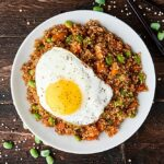 Quinoa fried rice with egg on plate above