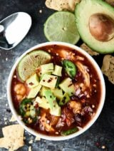 Enchiladas are now quicker, easier, and less messy with thisSlow Cooker Enchilada Soup Recipe! Full of chicken, beans, and hominy, this recipe is healthy and delicious! 5 minutes of prep. Gluten free. showmetheyummy.com #enchilada #crockpot