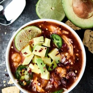 Enchiladas are now quicker, easier, and less messy with this Slow Cooker Enchilada Soup Recipe! Full of chicken, beans, and hominy, this recipe is healthy and delicious! 5 minutes of prep. Gluten free. showmetheyummy.com #enchilada #crockpot