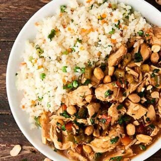 Slow Cooker Kung Pao Chicken. Tender chicken, loads of veggies, and a delicious sauce! Perfect when served over brown rice or cauliflower rice! Easy. Healthy. Can be gluten free! showmetheyummy.com #crockpot #kungpao #chicken #healthy
