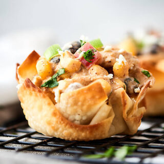 Southwestern chicken salad cups. Baked wonton cups filled with chicken, corn, beans, peppers, greek yogurt, lime, and taco seasonings! About 100 calories per cup! Great for easy lunches, snacks, or a big party! showmetheyummy.com #wonton #chickensalad