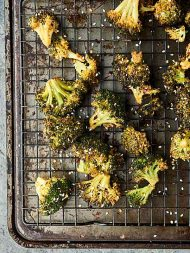 Roasted broccoli turned up a notch, this Asian Roasted Broccoli Recipe is healthy and full of coconut oil, soy sauce, spices, and just a touch of sriracha! Vegan. Can be gluten free.showmetheyummy.com #broccoli #vegan #glutenfree
