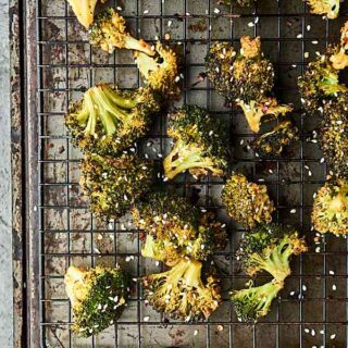 Roasted broccoli turned up a notch, this Asian Roasted Broccoli Recipe is healthy and full of coconut oil, soy sauce, spices, and just a touch of sriracha! Vegan. Can be gluten free. showmetheyummy.com #broccoli #vegan #glutenfree