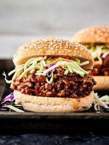An Asian twist on a classic, these Asian Sloppy Joes are seriously SO delicious. Full of ground pork, hoisin sauce, ginger, chili garlic sauce, and more! You'll never guess this flavor packed recipe is SO easy! showmetheyummy.com #sloppyjoes #asian