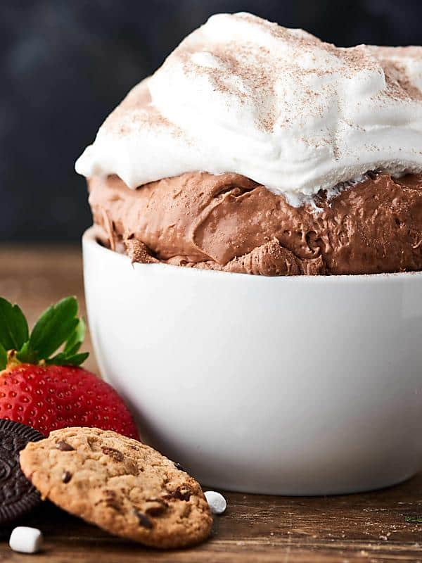 This Hot Chocolate Cheesecake Dip Recipe only requires 6 ingredients and 10 minutes of prep! Full of cream cheese, yogurt, marshmallow creme, hot cocoa mix, cool whip, and marshmallow bits! Serve with cookies, pretzels, fruit, and more! showmetheyummy.com #cheesecake #hotchocolate