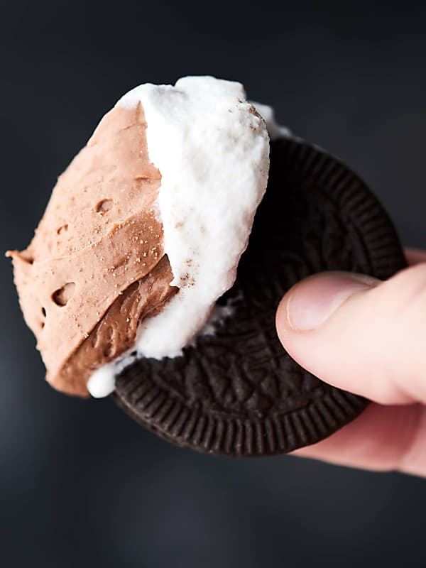 oreo with cheesecake dip held