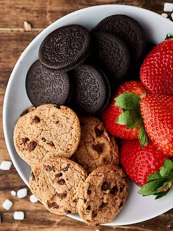 oreos, chocolate chip cookies, and strawberries on plate