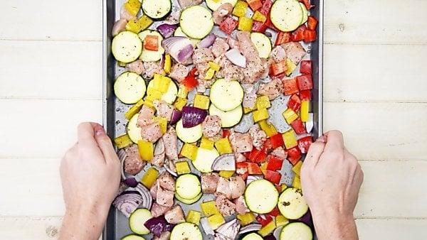 veggies and chicken on baking sheet