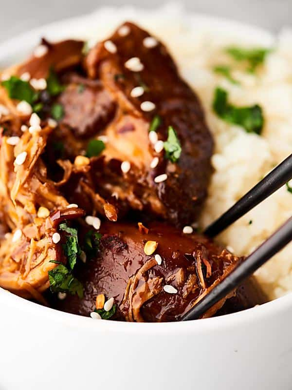 This Slow Cooker Teriyaki Chicken Recipe is the perfect, easy, healthy, and delicious week night dinner! My new favorite throw and go slow cooker recipe! showmetheyummy.com #teriyaki #chicken #crockpot