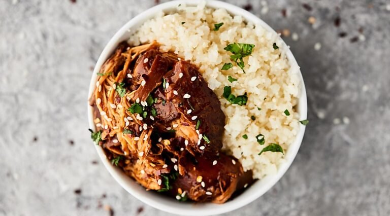 Bowl of teriyaki chicken with rice above
