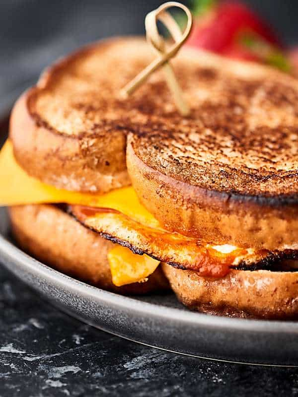closeup of breakfast grilled cheese on plate