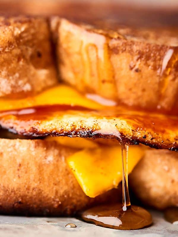 maple syrup dripping off grilled cheese sandwich closeup