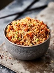 This ground turkey fried rice is a healthier twist on a take out classic! Leftover brown rice is mixed with a few veggies, extra lean ground turkey, spices, soy sauce, rice vinegar, hoisin, chili garlic sauce, and more!showmetheyummy.com #healthy #friedrice