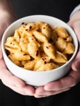 This Instant Pot Mac and Cheese Recipe only requires a few minutes and a few ingredients: pasta shells, broth, salt, pepper, milk, parmesan, gruyere, and sharp cheddar cheese to make! showmetheyummy.com #instantpot #macandcheese