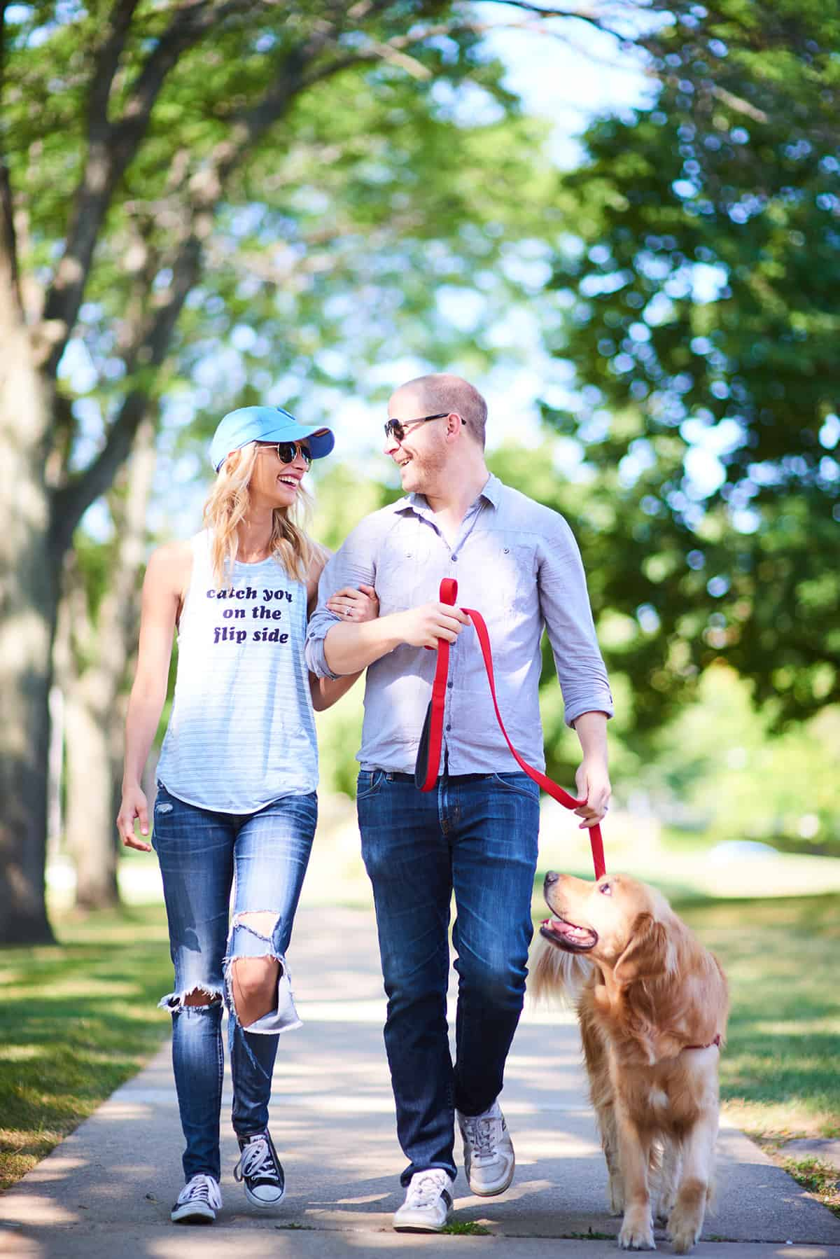 picture of man and woman walking dog