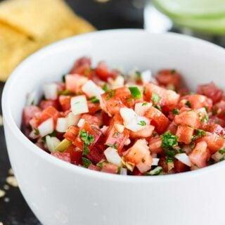 This Easy Pico de Gallo Recipe comes together in a matter of minutes! Fresh tomatoes, onion, cilantro, jalapeno, lime, & garlic make this truly delicious. showmetheyummy.com #picodegallo #healthy #vegan