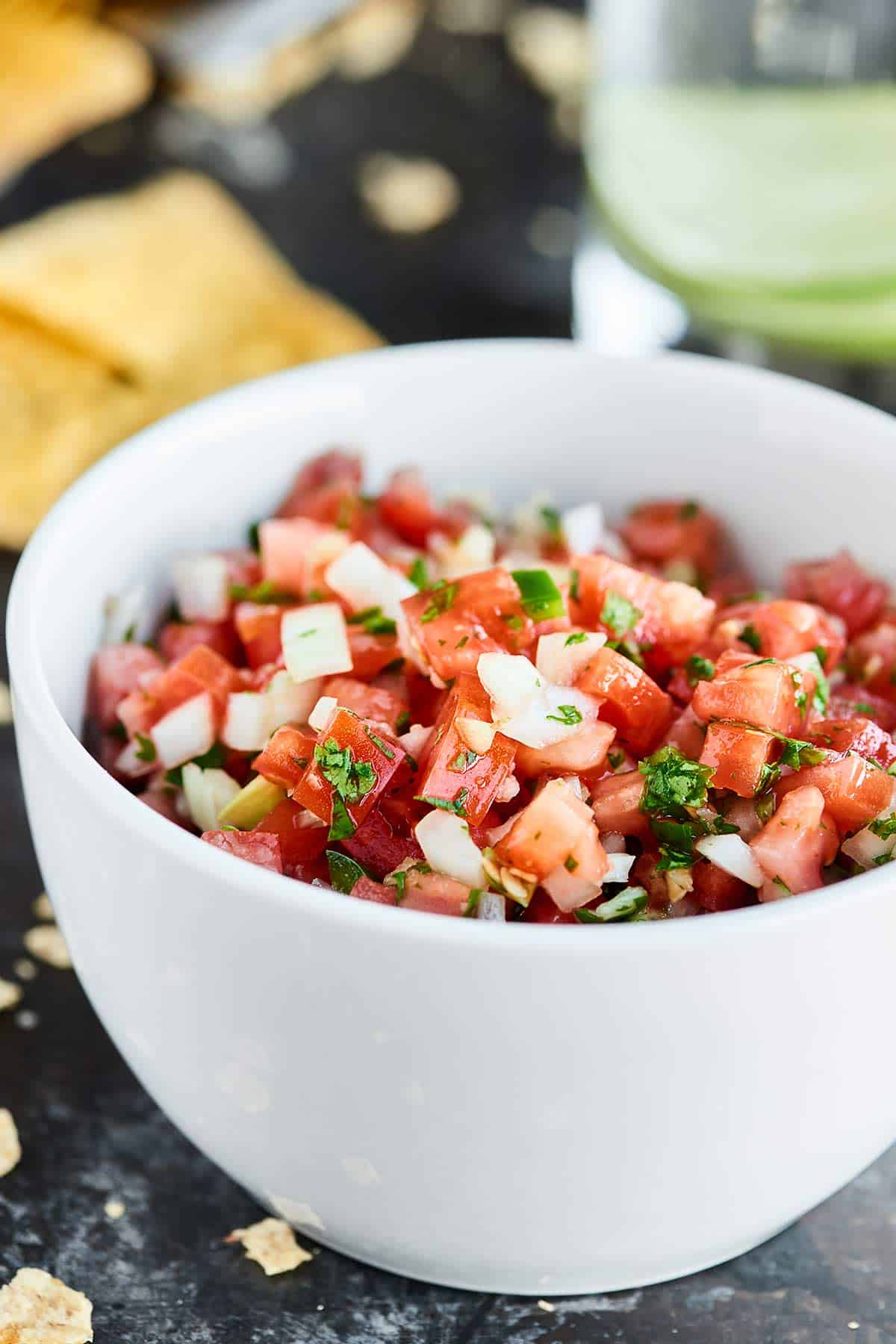 This Easy Pico de Gallo Recipe comes together in a matter of minutes! Fresh tomatoes, onion, cilantro, jalapeno, lime, & garlic make this truly delicious. showmetheyummy.com #picodegallo #healthy #vegan