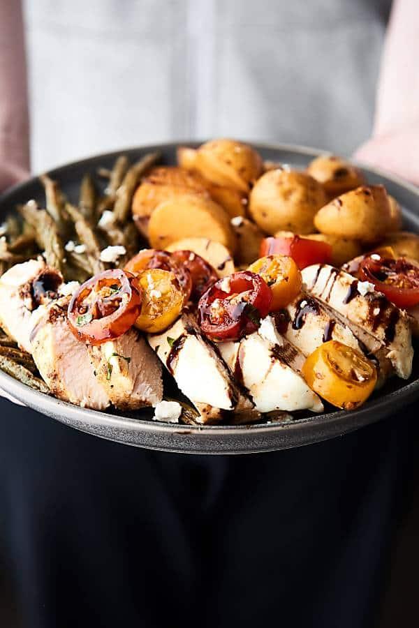 plate of bruschetta chicken held