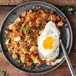 A healthy version of a take out classic, you're going to LOVE this Chicken Cauliflower Fried Rice Recipe. Super quick, easy, healthy, and of course delicious! A new low carb favorite. Loaded with pre-made frozen riced cauliflower and all your favorite fried rice flavors! showmetheyummy.com #chicken #friedrice #cauliflower #healthy