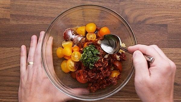 bruschetta ingredients in mixing bowl