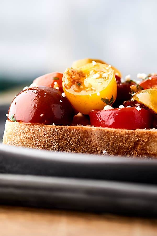 This easy bruschetta recipe is a healthy summer classic! Juicy tomatoes tossed with sun dried tomatoes, garlic, a touch of oil, balsamic vinegar, and fresh basil . . . we can't get enough of this stuff! showmetheyummy.com #bruschetta #summerrecipe #healthy #vegan