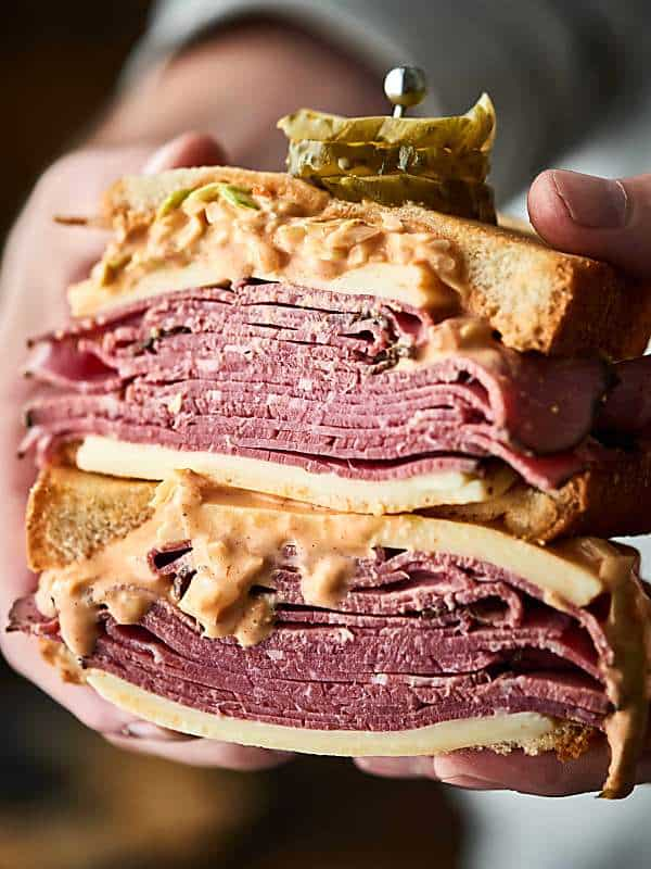#ad A twist on a classic, this pastrami sandwich is outta this world good! Artisan-style bread loaded with thinly sliced pastrami, swiss cheese, and the BEST coleslaw made with a tangy homemade russian dressing. Can be served hot or cold! showmetheyummy.com Made in partnership w/ @SaraLeeBread #saraleebread #artesanobread