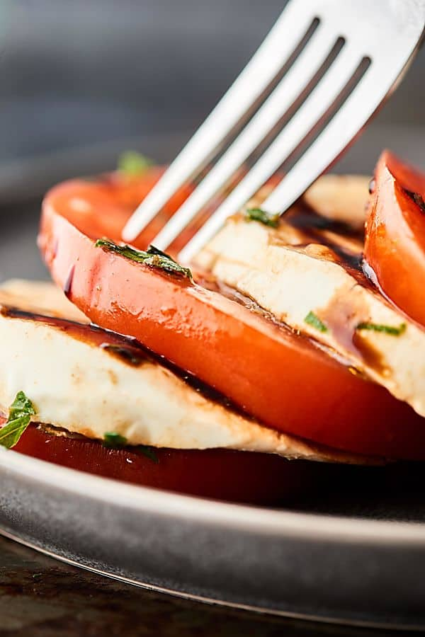 Mozzarella and tomato with fork closeup